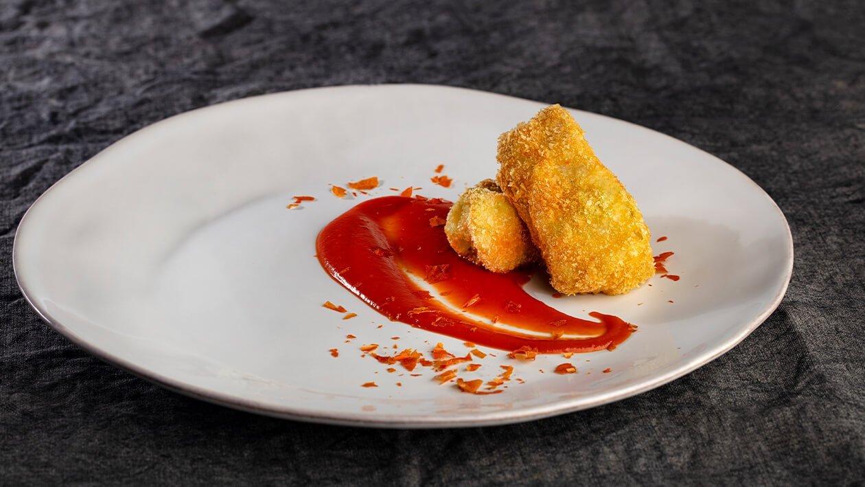Tranche de garoupa frita com aveludado de tomate